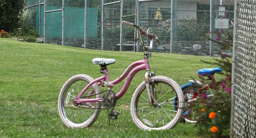 Children's bikes parked by the pool.