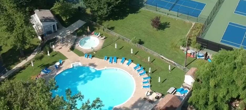The outdoor pool at Pine Tree Associates Nudist Club.